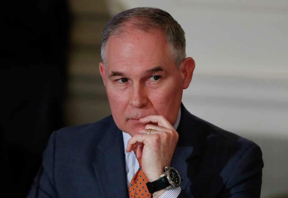 In this Feb. 12, 2018, photo, Environmental Protection Agency Administrator Scott Pruitt attends a meeting with state and local officials and President Donald Trump about infrastructure in the State Dining Room of the White House in Washington. Pruitt has broken months of silence about his frequent use of premium-class airfare at taxpayer expense, saying he needs to fly first class because of unpleasant interactions with other travelers.  (AP Photo/Carolyn Kaster) Photo: Carolyn Kaster, STF / Copyright 2018 The Associated Press. All rights reserved.
