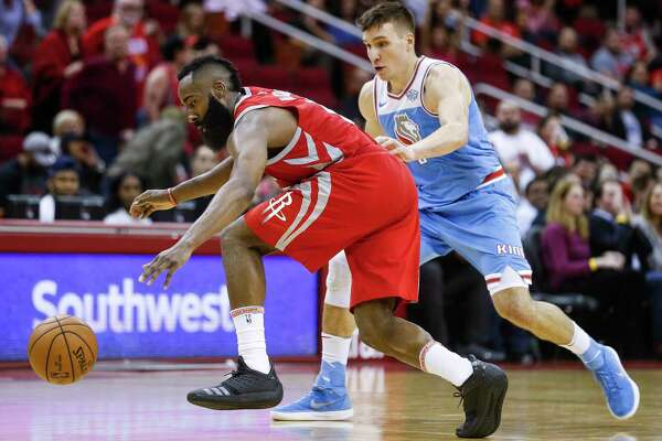 Houston Rockets guard James Harden (13) tries to drive past Sacramento Kings guard Bogdan Bogdanovic (8) as the Houston Rockets beat the Sacramento Kings 100-91 at the Toyota Center Wednesday, Feb. 14, 2018 in Houston.