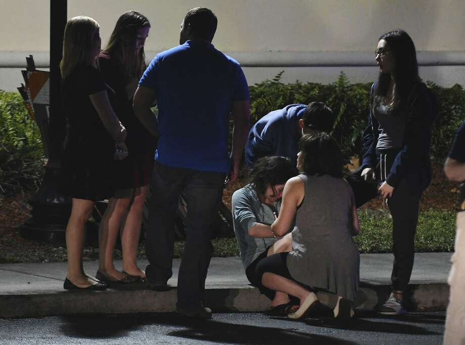 Parents meet at a hotel in Coral Springs, Fla., Wednesday, Feb. 14, 2018, to pick up their children, following a shooting at nearby Marjory Stoneman Douglas High in Parkland, Fla. A former student opened fire at the Florida high school Wednesday, killing more than a dozen people and sending scores of students fleeing into the streets. (Jim Rassol/South Florida Sun-Sentinel via AP) Photo: Jim Rassol, Associated Press