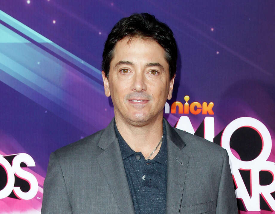 "FILE - In this Nov. 17, 2012 file photo, actor Scott Baio arrives at the TeenNick HALO Awards in Los Angeles. Former ""Charles in Charge"" actor Alexander Polinsky says Baio assaulted and ""mentally tortured"" him during their time together on the show in the 1980s. Polinsky made the allegations Wednesday, Feb. 14, 2018, in Los Angeles during a news conference called by his attorney. (Photo by Joe Kohen/Invision/AP, File) Photo: Joe Kohen / Invision"