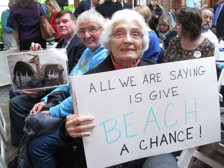 Activists in Hamilton, N.J., make their opposition known on Wednesday to President Donald Trump's plan to allow offshore oil and gas drilling along most of the nation's coastline.