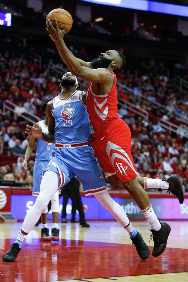 Rockets guard James Harden, who fininshed just short of a triple-double Wednesday, is fouled on the way to the bucket by the Kings' JaKarr Sampson (29). Photo: Michael Ciaglo, Houston Chronicle / Michael Ciaglo