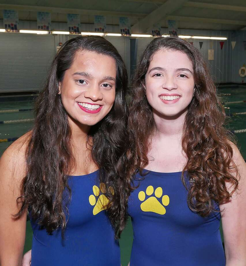 Alexander's Aneesa Mohammed and Chelsea Fuentes picked up silver medals at the Region IIIV-6A Regional meet to qualify for the UIL Class 6A State Swimming and Diving championships. Photo: Cuate Santos /Laredo Morning Times / Laredo Morning Times