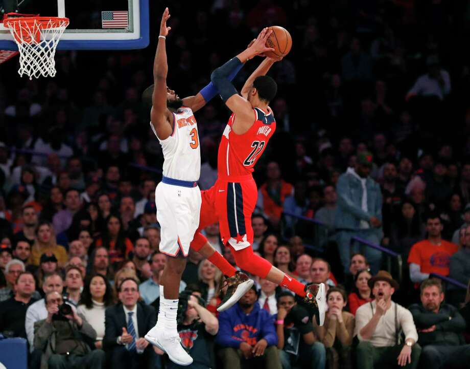 New York Knicks forward Tim Hardaway Jr. (3) fouls Washington Wizards forward Otto Porter Jr. (22) in the second half of an NBA basketball game in New York, Wednesday, Feb. 14, 2018. The Wizards defeated the Knicks 118-113. (AP Photo/Kathy Willens) Photo: Kathy Willens / Associated Press