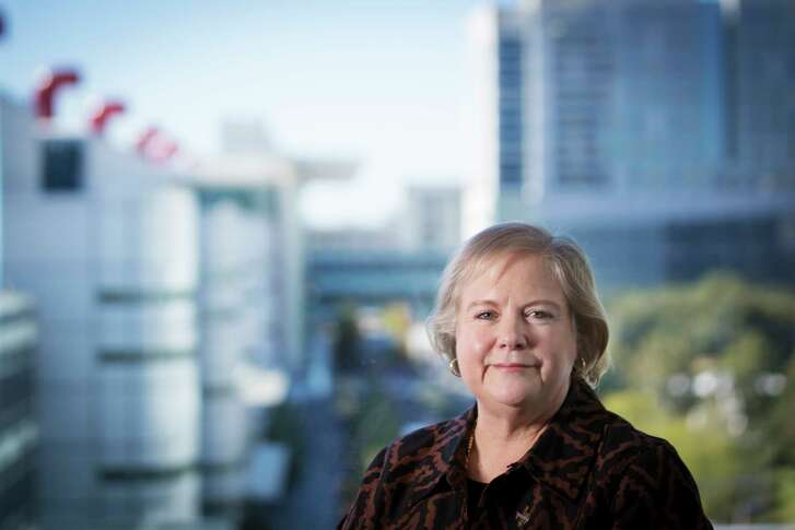Dawn R. Ullrich stands by a window near the George R. Brown Convention Center. Ullrich has been president and chief executive officer of Houston First Corporation since 2011. Thursday, Oct. 26, 2017, in Houston. ( Marie D. De Jesus / Houston Chronicle )