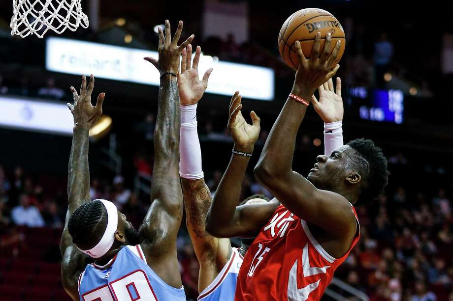 Rockets center Clint Capela, right, rises above the sea of Sacramento arms to put up a shot Wednesday night at Toyota Center. Capela had 13 points. Photo: Michael Ciaglo, Houston Chronicle / Michael Ciaglo