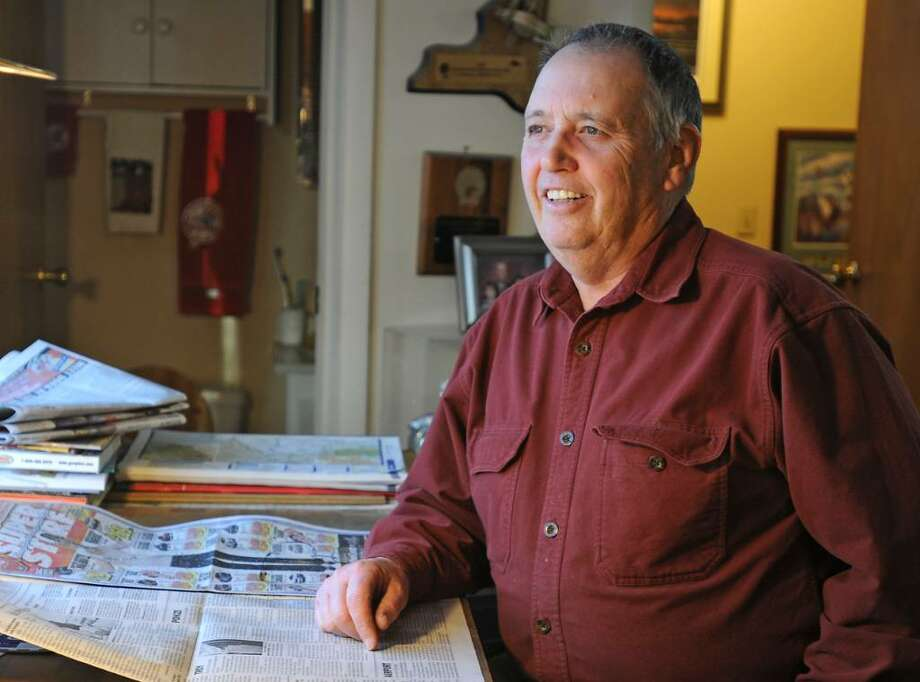 Mel Burger sits in his home on Niska Isle in Niskayuna. (Lori Van Buren / Times Union) Photo: LORI VAN BUREN