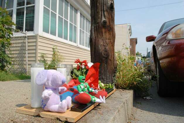 A memorial is set up on 4th Street in South Troy  where 5-year-old Khayzier Pugh darted out between two parked cars and into traffic Tuesday afternoon.  The boy was struck by a police vehicle while crossing the street and later died at the hospital. Buckowski / Times Union) Photo: PAUL BUCKOWSKI