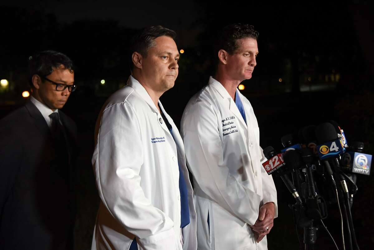 """Dr. Igor Nichiporenko (L), Medical Director of Trauma Surgeons, and Dr. Evan Boyar (R), Medical Director of Emergency Surgeons, both of the Broward Health Emergency facility where victims of a shooting at Marjory Stoneman Douglas High School were treated, speak to the media in Parkland, Florida on Febreuary 14, 2018. A former student armed with an AR-15 rifle opened fire at a Florida high school, killing at least 17 people, officials said, in a harrowing shooting spree that saw terrified students hiding in closets and under desks as they texted for help. Broward County Sheriff Scott Israel identified the gunman as Nikolas Cruz, 19, a former student at Marjory Stoneman Douglas High School in Parkland who had been expelled for """"disciplinary reasons."""" / AFP PHOTO / Douglas CURRANDOUGLAS CURRAN/AFP/Getty Images"""