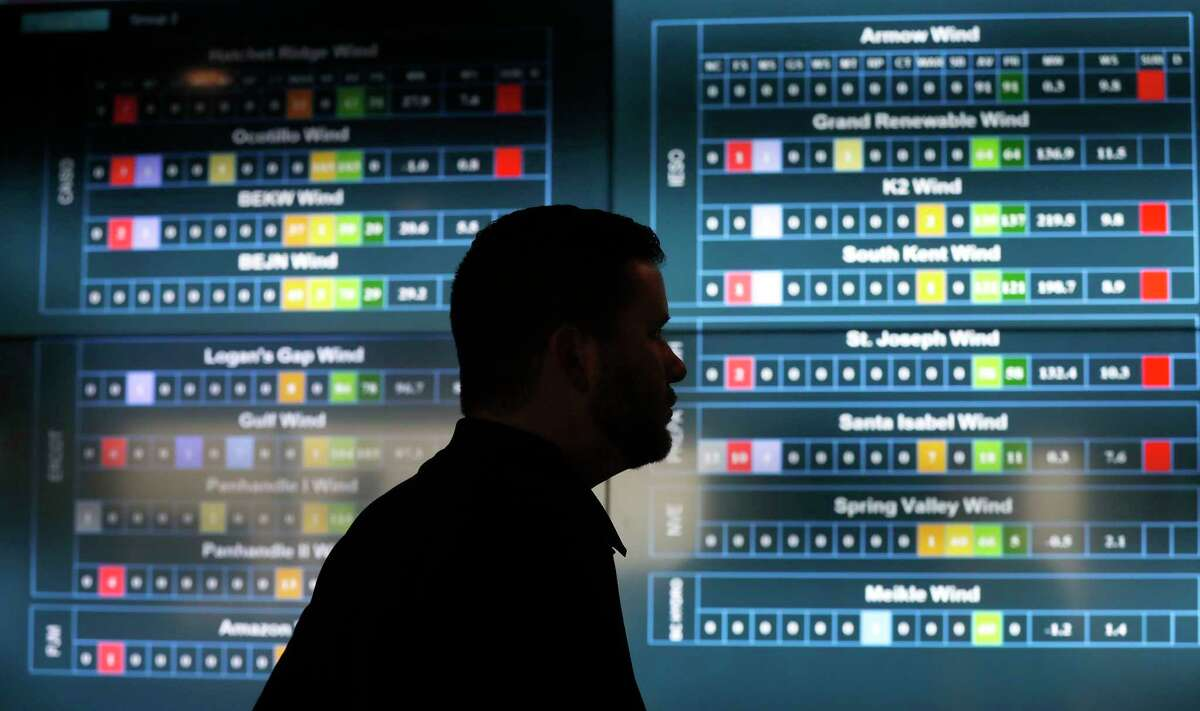Lance Haacke, Manager of the Operations Control Center stands near a real-time readout of turbine information in the Operations Center at Pattern Energy, Thursday, Feb. 1, 2018, in Houston. ( Karen Warren / Houston Chronicle )