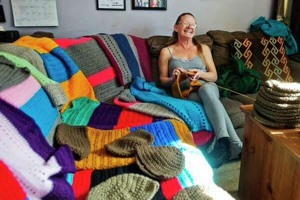 Debra Parady of Sanford poses Monday for a portrait with items she has crocheted for veterans. (Katy Kildee/kkildee@mdn.net)