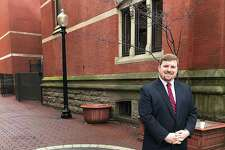 Newly named Greater Danbury Chamber of Commerce President and CEO P.J. Prunty stands in downtown Danbury, Conn., on Thursday, Feb. 15, 2018.