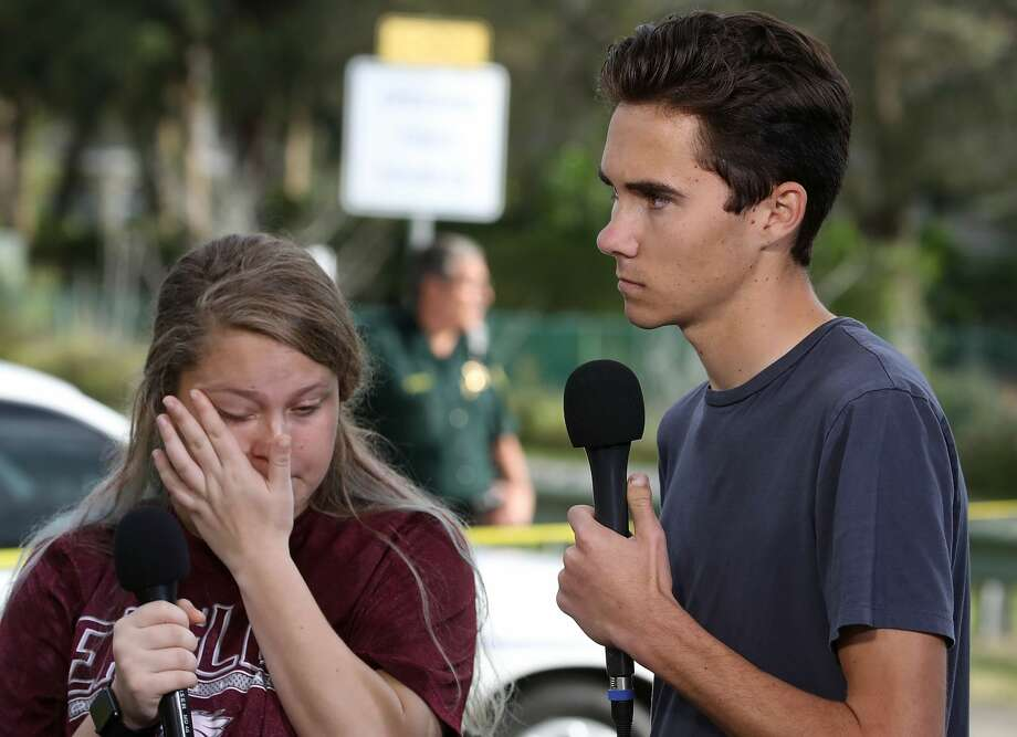 Students Kelsey Friend (L) and David Hogg recount their stories about yesterday's mass shooting at the Marjory Stoneman Douglas High School where 17 people were killed, on February 15, 2018 in Parkland, Florida. Police arrested the suspect after a short manhunt, and have identified him as 19 year old former student Nikolas Cruz. Photo: Mark Wilson/Getty Images