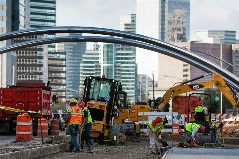 Construction crews work along Post Oak Boulevard  Feb. 14 as part of a project to add bus lanes in the center of the street. Metropolitan Transit Authority is about to purchase 14 buses for the Uptown Bus Rapid Transit project, expected to open in mid-2019. Photo: Michael Ciaglo, Houston Chronicle / Michael Ciaglo