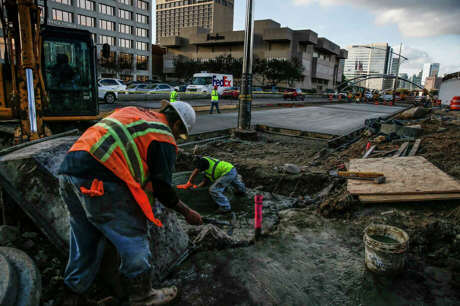 Construction crews work along Post Oak Boulevard  Feb. 14 as part of a project to add bus lanes in the center of the street. The revised street will have the same number of lanes open to general traffic, as well as pedestrian amenities. Photo: Michael Ciaglo, Houston Chronicle / Michael Ciaglo