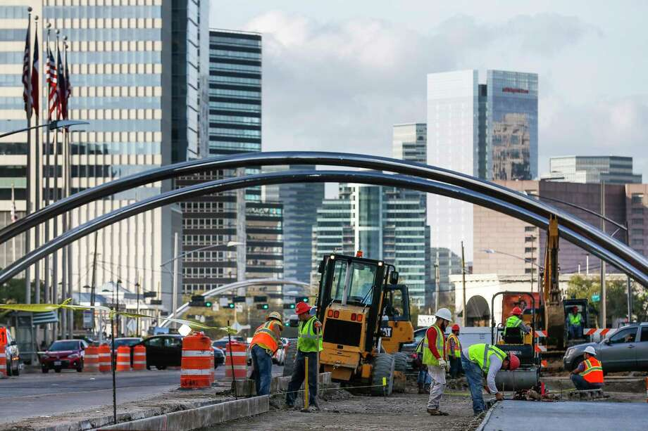 Construction crews work along Post Oak Boulevard  Feb. 14 as part of a project to add bus lanes in the center of the street. Photo: Michael Ciaglo, Houston Chronicle / Michael Ciaglo
