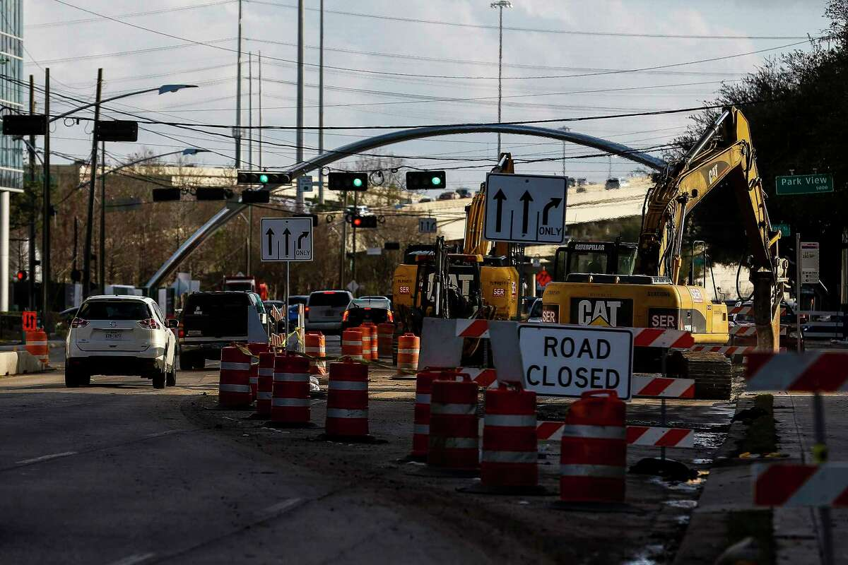 Construction crews work along Post Oak Boulevard Feb. 14 as part of a project to add bus lanes in the center of the street. Metropolitan Transit Authority is about to purchase 14 buses for the Uptown Bus Rapid Transit project, expected to open in mid-2019.