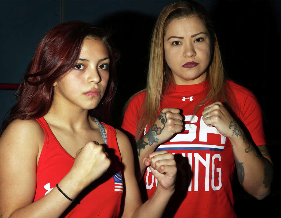 ADVANCE FOR USE SUNDAY, FEB. 18 AND THEREAFTER  Kayla Gomez, left, and her mother, Crystal Aceves, have amassed an impressive collection of title belts. (Rudy Gutierrez/El Paso Times via AP) Photo: Rudy Gutierrez, AP / El Paso Times