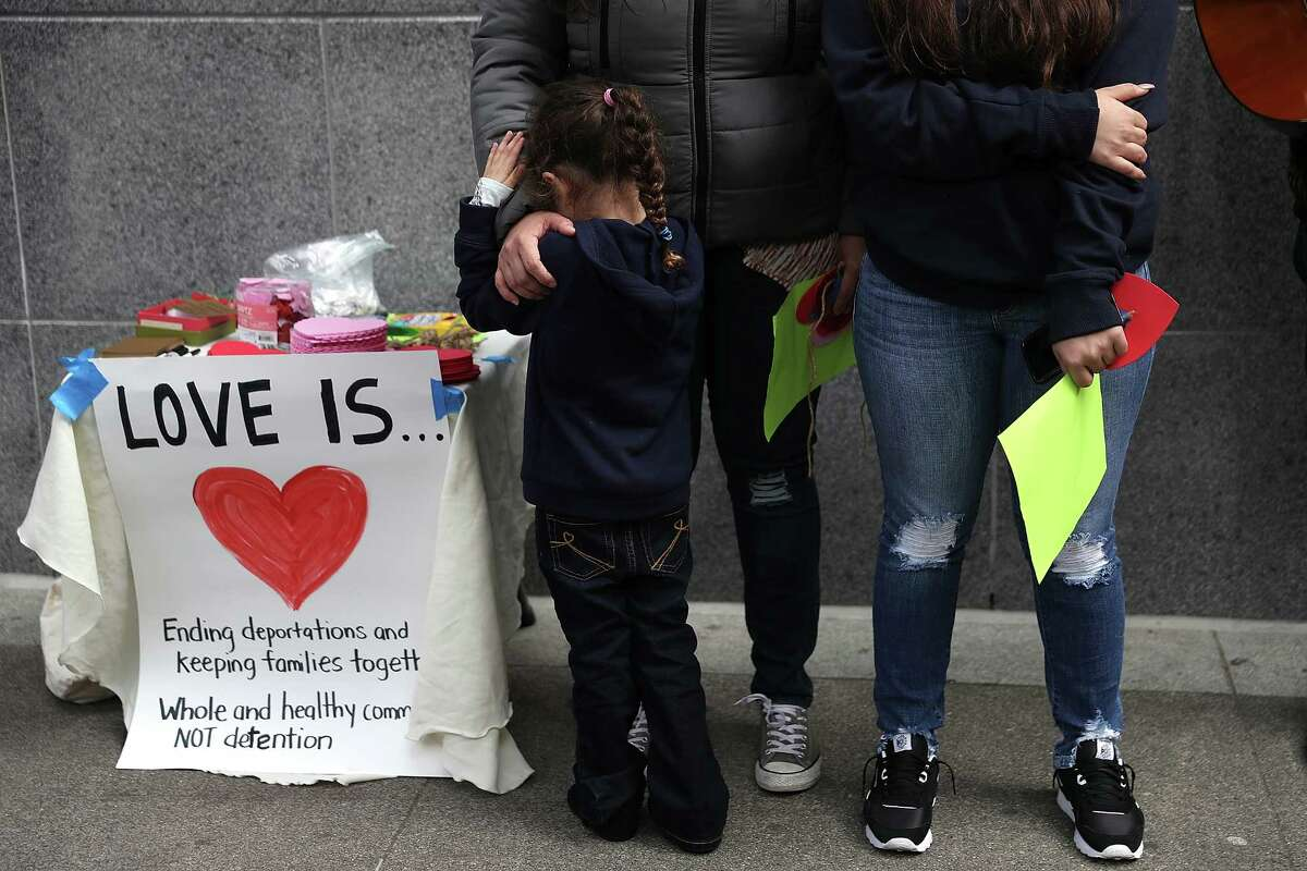 SAN FRANCISCO, CA - FEBRUARY 14: Ana Barraza holds her mother Lourdes Barraza, (C) wife of detained immigrant Fernando Barraza, during a Valentine's Day demonstration outside of the San Francisco office of the Immigration and Cutsoms Enforcement (ICE) on February 14, 2018 in San Francisco, California. Dozens of immigration activists and faith leaders staged a Vaentine's Day demonstration outside of the ICE offices in San Francisco to denounce detained immigrants and the lack of progress with DACA.