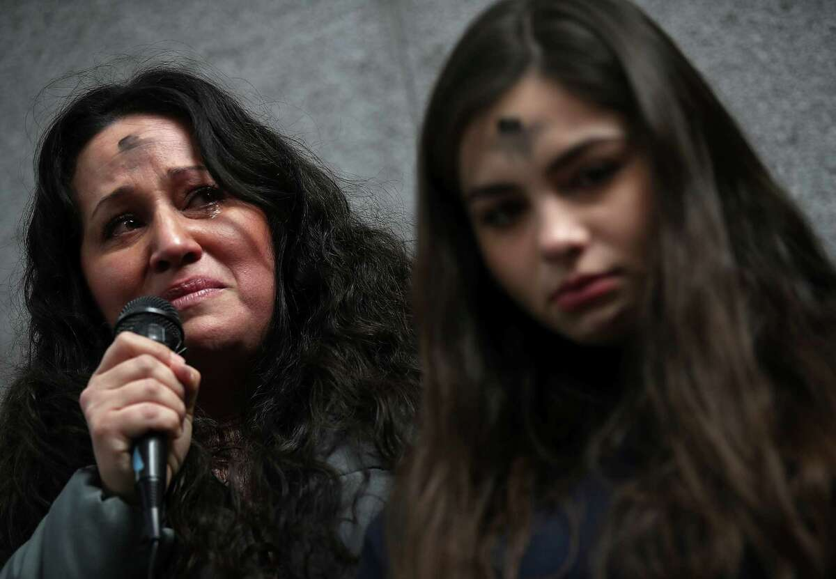 SAN FRANCISCO, CA - FEBRUARY 14: Lourdes Barraza, (L) wife of detained immigrant Fernando Barraza, fights back tears as she speaks during a Valentine's Day demonstration outside of the San Francisco office of the Immigration and Cutsoms Enforcement (ICE) on February 14, 2018 in San Francisco, California. Dozens of immigration activists and faith leaders staged a Vaentine's Day demonstration outside of the ICE offices in San Francisco to denounce detained immigrants and the lack of progress with DACA.