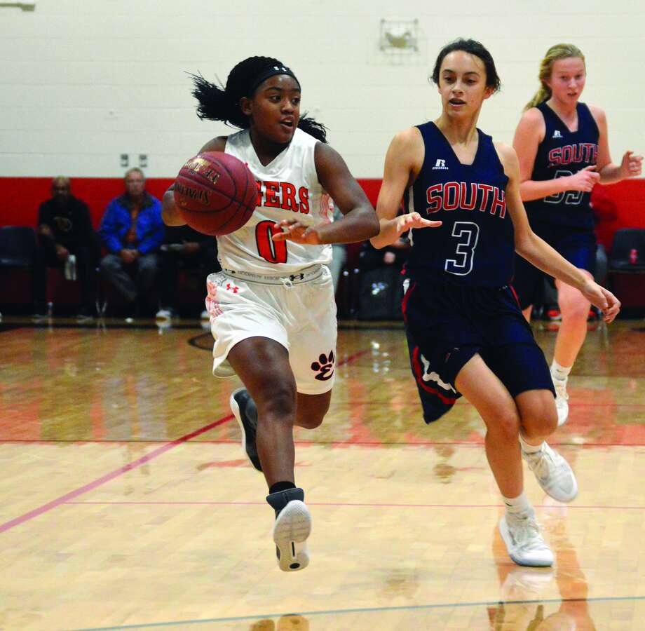 Edwardsville sophomore point guard Quierra Love, left, races up the court during a game against Parkway South.