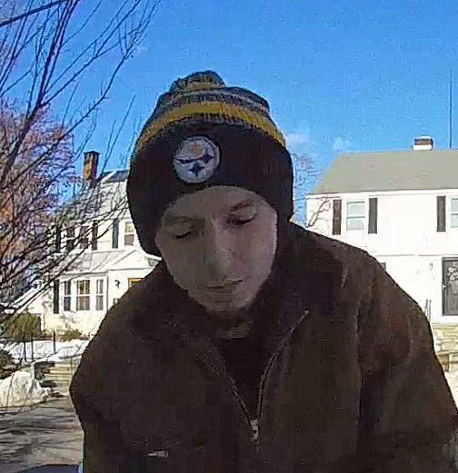 The Stratford Police Department is attempting to identify the person pictured for stealing a package from the front porch of a residence on Wilcoxson Avenue. Photo: /