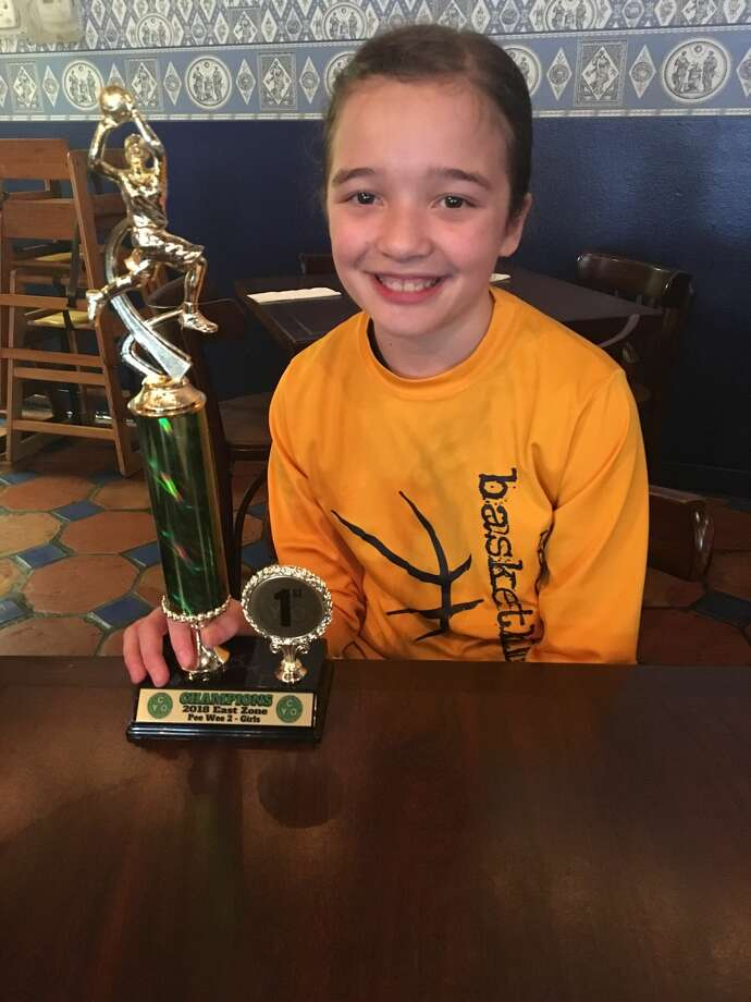Madeline Florence, 10, is the point guard for the basketball team at St. Anthony's Catholic School. Mom Sharon Florence says she made about 12 of the 17 points in the team's win over Our Lady of Perpetual Help, including the thrilling buzzer-beater. Photo: Coutesy, Florence Family