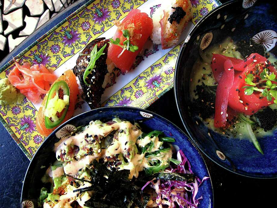 A nigiri sampler, tuna sashimi and a tuna poke bowl from Hanzo. Photo: Mike Sutter /San Antonio Express-News