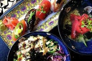 A nigiri sampler, tuna sashimi and a tuna poke bowl from Hanzo.