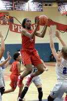 Travis' Queen Egbo had a monster game to help her team to the first playoff victory in program history.