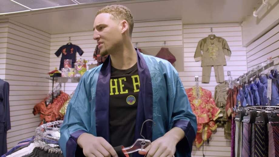 Klay Thompson enjoys his visit to Chinatown. Photo: Golden State Warriors Via YouTube