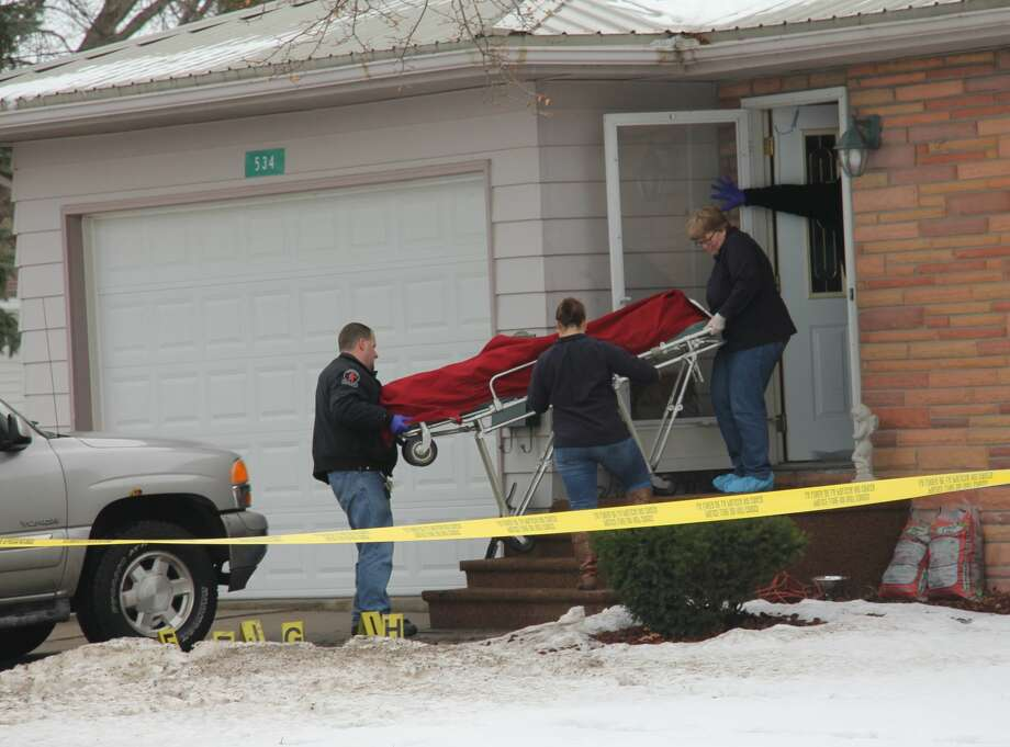 Forensic lab officials removed the victims from double homicide and suicide home, located in the 500 block of Beach Street in Sebewaing. Police have identified the victims as a father, mother and daughter, but have not released the names yet. Photo: Brenda Battel/Huron Daily Tribune