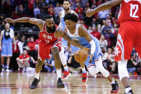 Houston Rockets guard James Harden (13) attempts to take the ball away from Sacramento Kings guard De'Aaron Fox (5) as the Houston Rockets beat the Sacramento Kings 100-91 at the Toyota Center Wednesday, Feb. 14, 2018 in Houston. (Michael Ciaglo / Houston Chronicle)