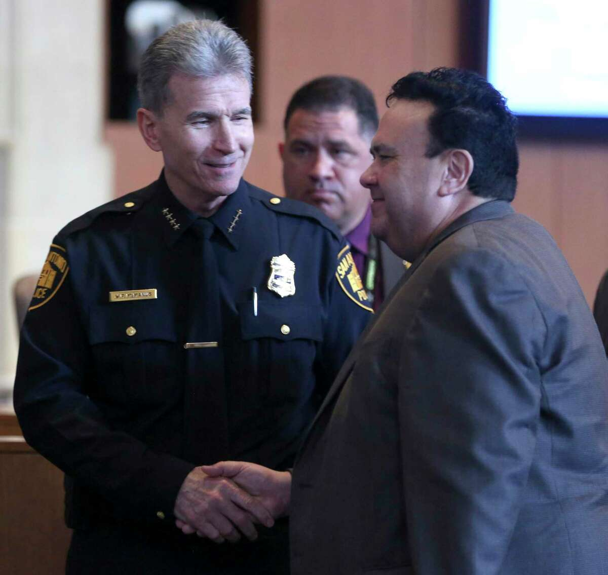 San Antonio police chief William McManus, left, shakes hands with Richard Wells, president and owner of Dailey-Wells Communications, Thursday, Feb. 15, 2018 in council chambers his company was awarded a 15-year, $106 million contract to build the city's next public safety radio network. Dailey-Wells received the contract with 8 yeas, two absent, and one not voting council member.