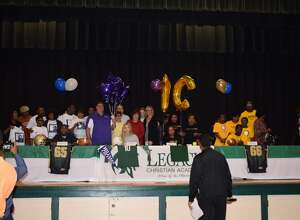 Legacy's Evan Thibodeaux, Bella Winslow, Nautica Richard and Dwight Johnson (left to right) sign their national letters of intent on Feb. 14, 2018. (Photo provided by Legacy Christian)