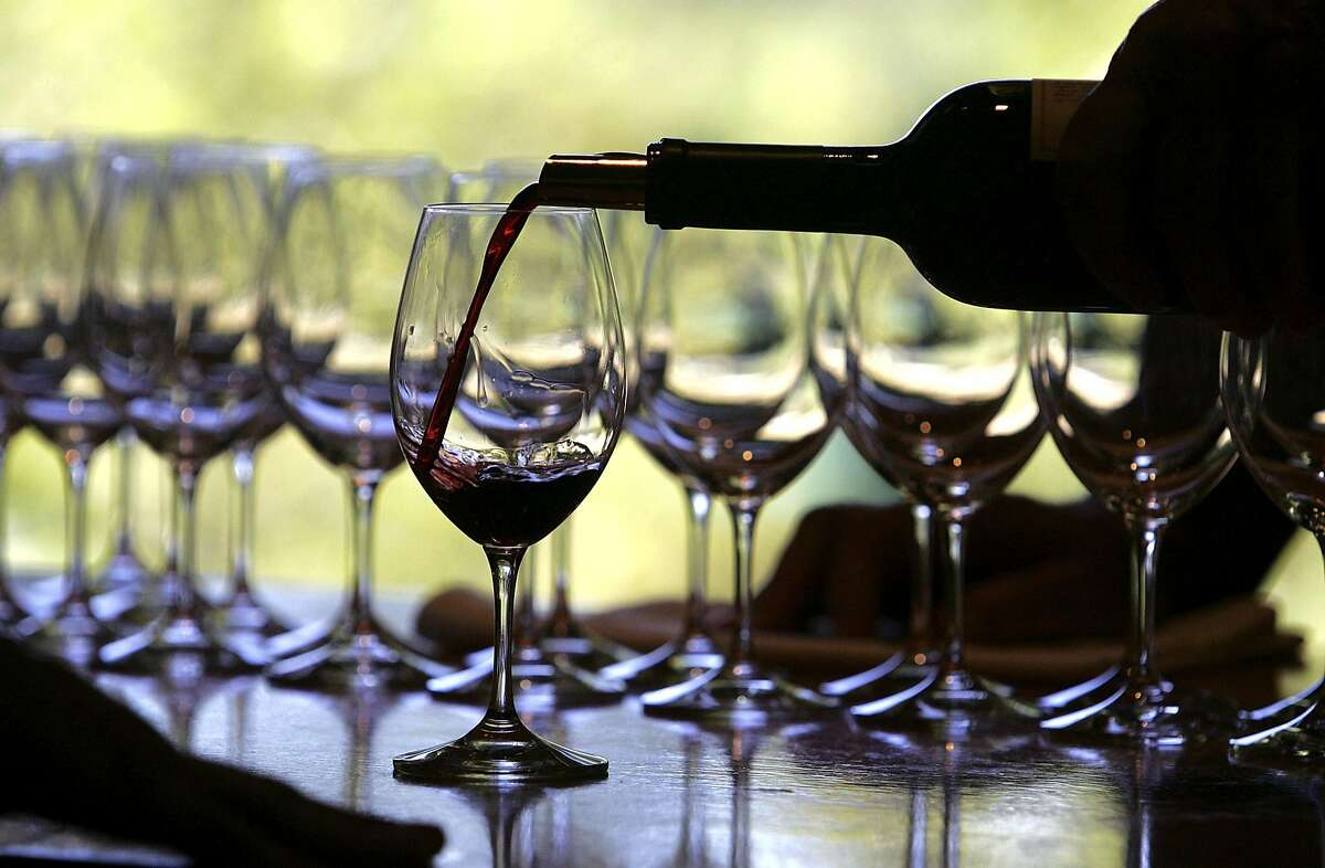 RUTHERFORD, CA - SEPTEMBER 20: A worker at St. Supery winery pours a glass of wine for a tasting September 20, 2006 in Rutherford, California. Wineries in the Napa Valley region are in the midst of harvesting their 2006 crop and will pick and crush grapes until about mid-October. (Photo by Justin Sullivan/Getty Images)