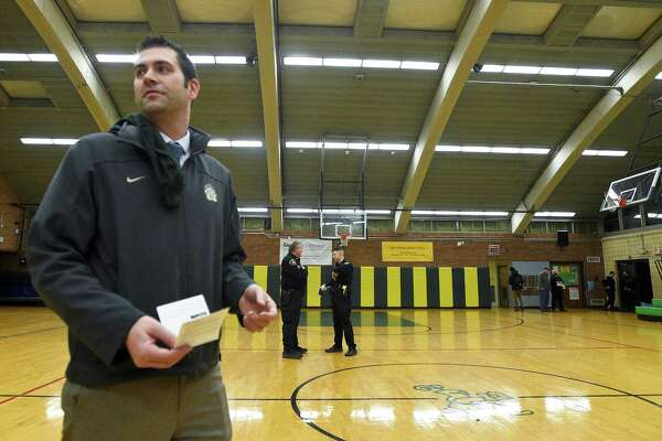 Norwalk varsity boys basketball coach Tom Keyes holds a summons issued by Stamford Police, following an incident that occur following the playing of the freshman boys basketball game at Trinity Catholic High School on Friday, Jan. 12, 2018.