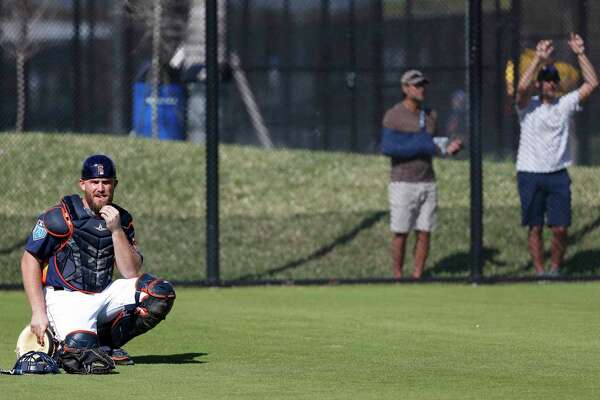 Houston Astros catcher Max Stassi (12) watches a bullpen session as the pitchers and catchers worked out during spring training at The Ballpark of the Palm Beaches, Thursday, Feb. 15, 2018, in West Palm Beach .