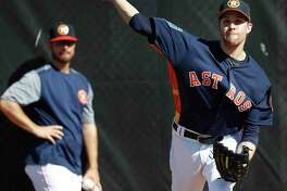 Houston Astros RHP pitcher Collin McHugh (31) throws a bullpen session as the pitchers and catchers worked out during spring training at The Ballpark of the Palm Beaches, Thursday, Feb. 15, 2018, in West Palm Beach .