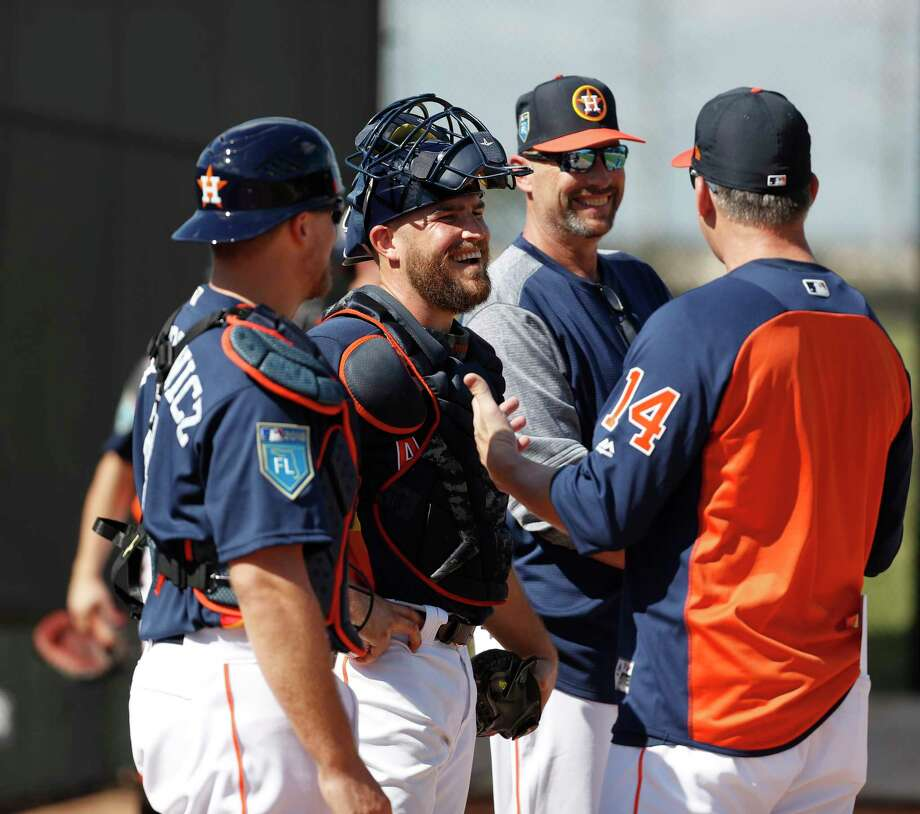 Houston Astros catchers Max Stassi (12) and Tim Federowicz (44) laugh with manager A.J. Hinch (14) as the pitchers and catchers worked out during spring training at The Ballpark of the Palm Beaches, Thursday, Feb. 15, 2018, in West Palm Beach . Photo: Karen Warren, Houston Chronicle / © 2018 Houston Chronicle