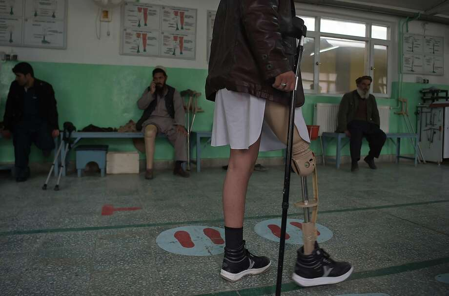 An Afghan amputee walks with his prosthetic leg at a hospital for war victims in the capital, Kabul. Photo: SHAH MARAI, AFP/Getty Images