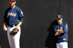 Houston Astros manager A.J. Hinch (14) watches RHP pitcher Chris Devenski (47)  throw a bullpen session as the pitchers and catchers worked out during spring training at The Ballpark of the Palm Beaches, Thursday, Feb. 15, 2018, in West Palm Beach .