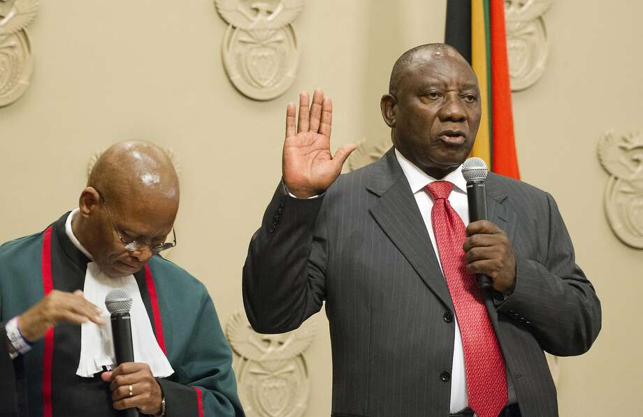 Cyril Ramaphosa is sworn in as South African President by Chief Justice Mogoeng Mogoeng (left) in Cape Town. He is the fifth president since the end of white minority rule. Photo: Rodger Bosch, Associated Press