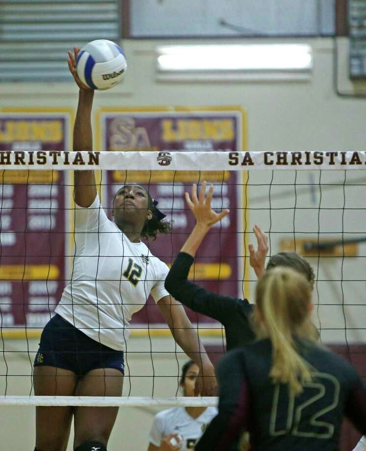 Holy CrossÕs Faye Wilbricht knocks spikes the ball against SA Christian from the TAPPS 5-5A opener between Holy Cross and S.A. Christian at S.A. Christian HS on Wednesday Sept. 20, 2017 Photo: Ron Cortes, Freelance / For The San Antonio Express-News