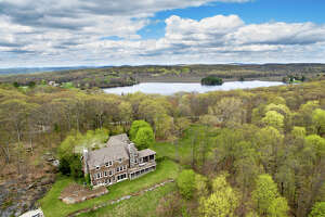 The lakehouse at 40 Spectacle Ridge Road in Kent is built on the former site of Camp Kent, one of a dozen or so camps in town during the 1900s. It offers sweeping views of  Lake Waramaug and Kent's farmland, as well as access to South Spectacle Lake.