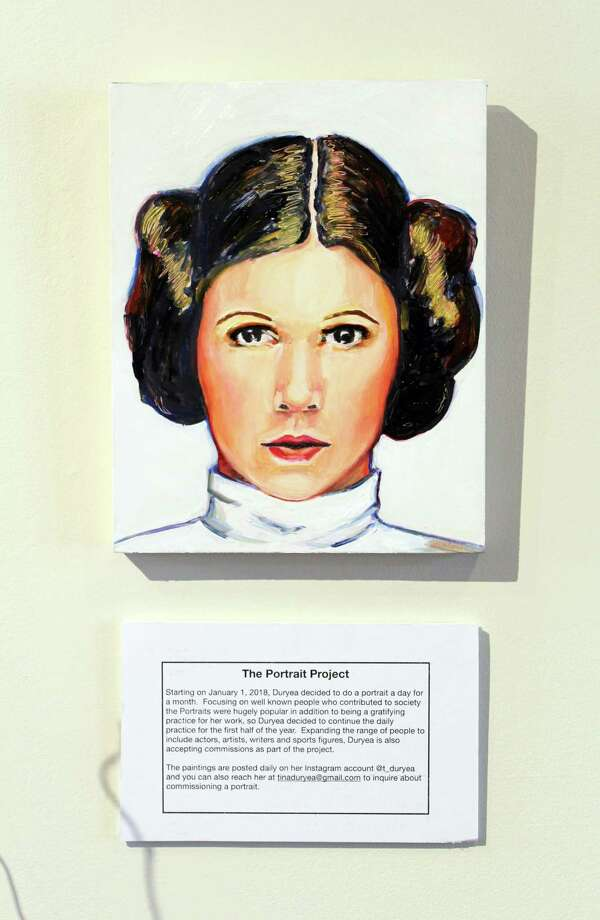 "A painting of Princess Leia from Tina Duryea's portrait series on display in the Darien Nature Center in Darien, Conn. Duryea's work will be on display as part of her exhibit ""Two Perspectives"" through March 16, 2018. Photo: Erin Kayata / Hearst Connecticut Media / Darien News"