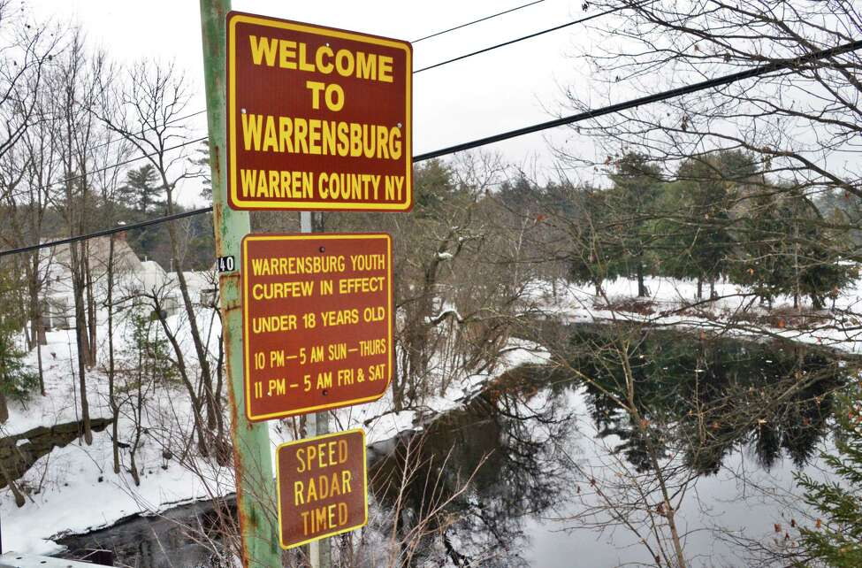 A Welcome to Warrensburg sign over the Schroon River along Route 9, Thursday Feb. 15, 2018 in Warrensburg, NY. (John Carl D'Annibale/Times Union)
