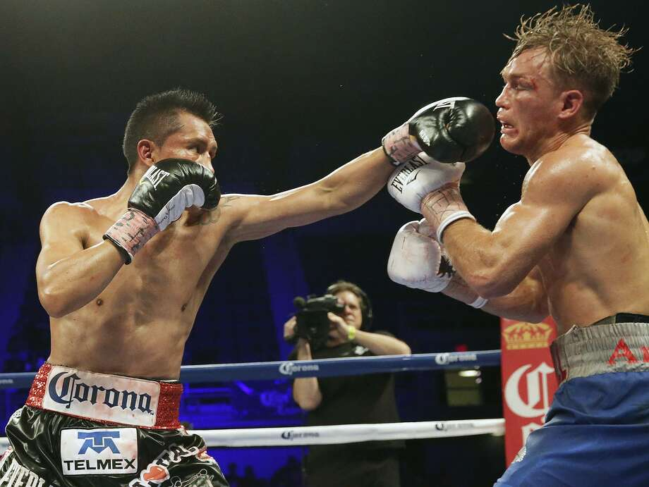 Francisco Vargas punishes with shots to the face as he fights Will Tomlinson in the feature boxing event at Freeman Coliseum on March 12, 2015. Photo: Tom Reel / San Antonio Express-News