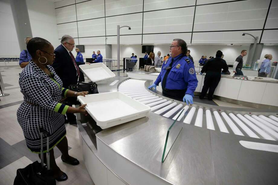TSA officials demonstrate an automated screening lane system for departing passengers at the TSA security checkpoint in Terminal D at Bush Intercontinental Airport Thursday, Feb. 15, 2017. Photo: Melissa Phillip, Houston Chronicle / Houston Chronicle 2018
