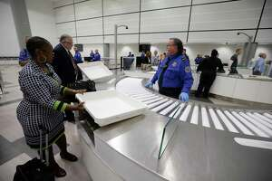 TSA officials demonstrate an automated security lane system for departing passengers at the TSA security checkpoint in Terminal D at Bush Intercontinental Airport Wednesday, Feb. 15, 2017.